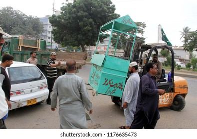 KARACHI, PAKISTAN - SEP 10: Anti encroachment operation in progress demolishing illegal encroachment during anti encroachment drive under the supervision of KMC, on September 10, 2018 in Karachi