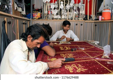 KARACHI, PAKISTAN - SEP 10: Artisans embroidery Azadari items use in mourning rituals of Imam Hussain being selling, on the arrival of Holy month of Muharramul-Haram,  on September 10, 2018 in Karachi