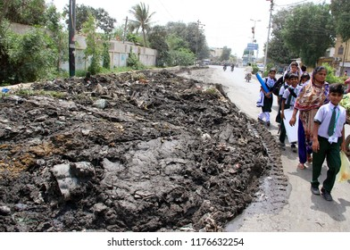 KARACHI, PAKISTAN - SEP 10: Heap of Garbage creating an unhygienic atmosphere and problems for commuters and showing negligence of concerned authorities, at Malir area on September 10, 2018 in Karachi
