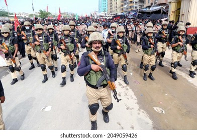 KARACHI, PAKISTAN - SEP 28: Security officials stand high alert during Shiite mourning processions in connection of 40th day Chehlum-e-Hazrat Imam Hussain on September 28, 2021 in Karachi.