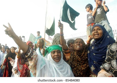 KARACHI, PAKISTAN - SEPT 27: Residents of Liyari chant slogans during protest rally against US Government at US Consulate building on September 27, 2011 in Karachi, Pakistan.