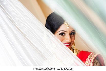 Karachi, Pakistan - September 16 2018: Beautiful Indian Bride eyes, eye brows, Kajal, golden jewellery and long black hair.