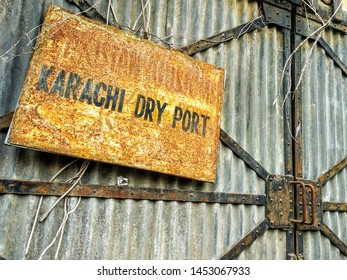 Karachi , Sindh, Pakistan: Jul 17 2019: A rusted board of Pakistan Railways Karachi Dry Port near Tower Karachi outside a locked warehouse