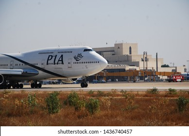 Karachi Sindh, Pakistan - March, 2019: PIA Pakistan International Aircraft on Runway of Quaid e Azam International Airport, Airlines Aeroplanes Taxing Pakistani