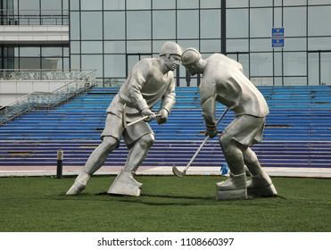 KARAGANDA. KAZAKHSTAN. 06 JUIY 2016 : Sculpture of hockey players near in front of Sports Complex Karaganda Arena in Karaganda. Kazakhstan