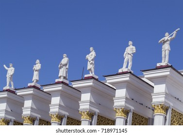 Karaganda, Kazakhstan - Aug 20, 2016: Statues on Club of Miners (1952). Miner & rock drill,shepherd & lamb, soldier, female farmer with sheaf, engineer & musician with dombra. Stalinist Empire style