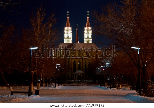 KARAGANDA, KAZAKHSTAN - DECEMBER 9, 2017: View on cathedral of the Blessed Virgin Mary of Fatima from the Victory Park