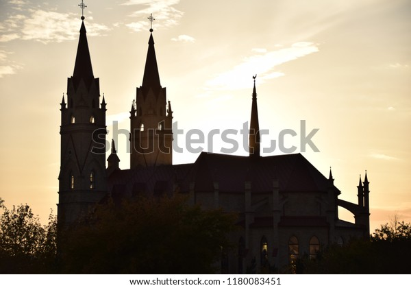KARAGANDA, KAZAKHSTAN - SEPTEMBER 15, 2018: View on cathedral of the Blessed Virgin Mary of Fatima from the Shakhterov avenue on a sunset