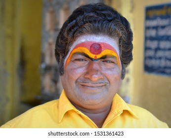KARAIKAL, PONDICHERRY / INDIA - FEB 25, 2016:  Indian Hindu Shaivite devotee with colourful tripundra and red tilak mark on his forehead poses for the camera, on Feb 25, 2016.