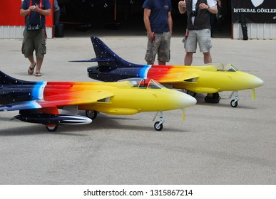 Karain Airport - Airshow / ANTALYA 24.05.2015: Airshow of the RC Jet models of airplanes. Aircraft  competition area. Hobbies and spending free time. Popular hobby among woman,  boys and teenagers.