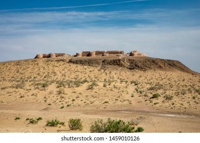 Karakalpakstan, Uzbekistan, Kyzylkum Desert, Central Asia. Desert landscape. Ayaz-Kala fortress, the most popular and picturesque fortress in the country.