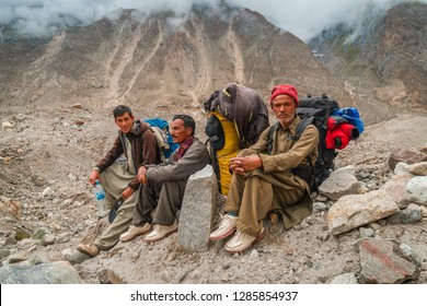 Karakoram, Pakistan - July 24, 2018: Sherpas having a rest during trek to K2 base camp in Karakoram Mountain Range in Pakistan. Illustrative editorial.