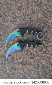 The karambit (as is spelled in the Philippines), kerambit (as used in Indonesian and Malaysian variants of Malay), kurambik, karambol or karambiak is a small Indonesian curved knife resembling a claw
