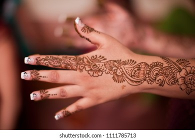 Karamsad, India - 6 February 2011: An unnamed member of the bridal party at an Indian wedding displays the traditional mehndi art on the back of her hand.