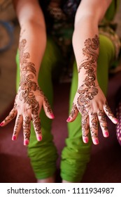Karamsad, India - 6 February 2011: An unnamed bridesmaid at an Indian wedding displays the henna tattoos traditionally painted on the hands and arms of the bridal party.