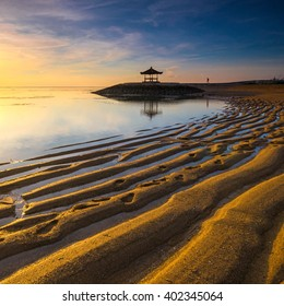 Karang Beach Sanur,Bali,Indonesia At Sunrise With Golden Sand Texture.Slightly noise and soft focus.