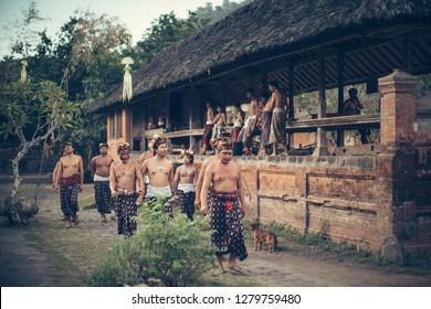 Karangansem, Bali / Indonesia - June 13, 2016 : Group of Villager from Tenganan Village walking to the ceremony area.