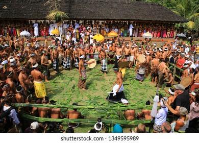Karangasem, Bali,Indonesia. 26 Juli 2013. PerangPandan/ Pandan Battle / Mageret Pandan or Makare-kare is a Balinese tradition of ritual combat with clubs made of pandan (Pandanus amaryllifolius).