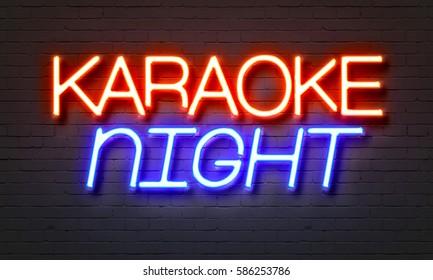 Karaoke night neon sign on brick wall background