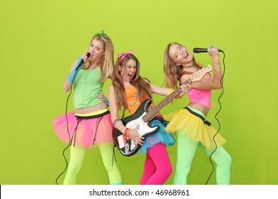 karaoke  teens singing with microphones and guitar