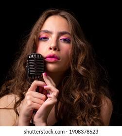 Karaoke woman. Girl singer with microphone. Sensual vintage girl singer. Concert sing