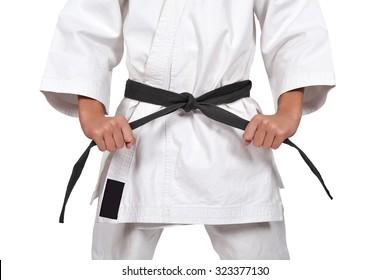 karate boy with black belt isolated on white background