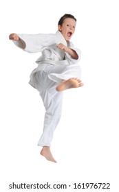 Karate boy jumping lifting his leg high