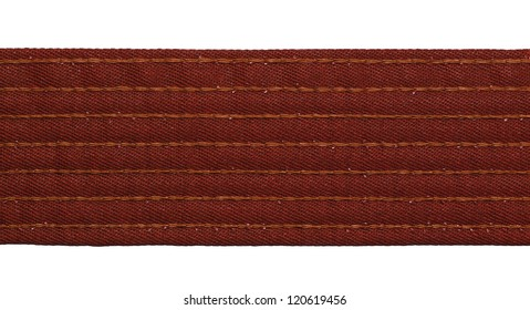 Karate brown belt closeup isolated on white background