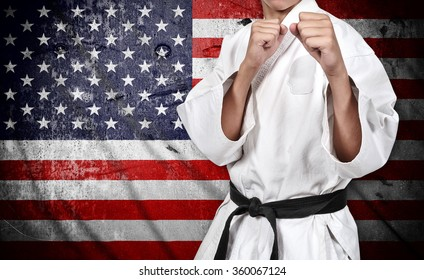 karate fighter  in kimono on american flag background