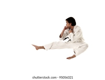 karate flying kick young male fighter isolated on white background.