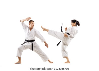 karate girl and boy against white background