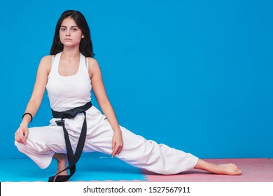 Karate girl pose. black belt