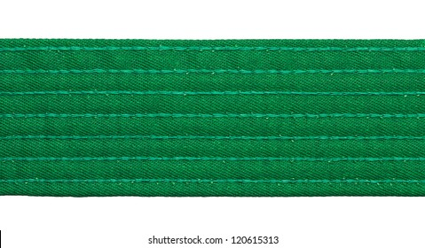 Karate green belt closeup isolated on white background