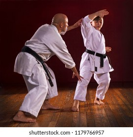 Karate instructor teaching martial arts to a child