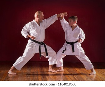 Karate instructor teaching martial arts to a kid