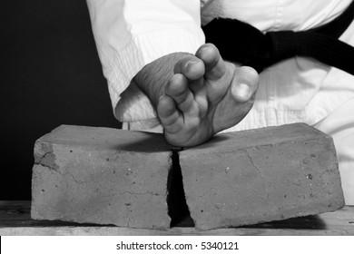 Karate man breaking the brick. B&W