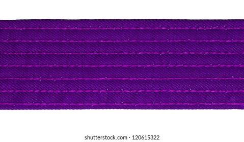 Karate purple belt closeup isolated on white background