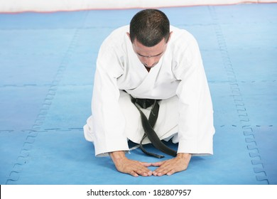 karate sensei demonstrating bowing in ceremony