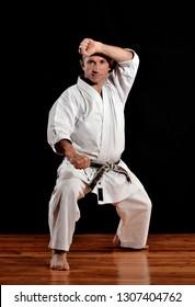 Karate shotokan master isolated on black background.
