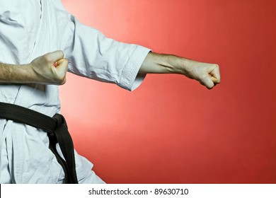 Karate training at gym over red background
