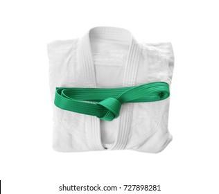 Karate uniform with green belt on white background