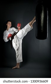Karate woman in action isolated in white