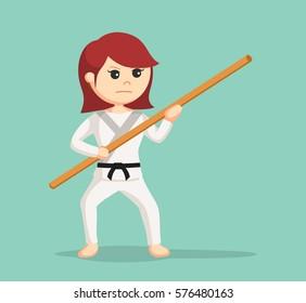 karate woman holding bo staff