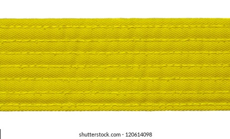Karate yellow belt closeup isolated on white background