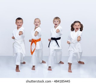 In karategi  athletes are training punch arm