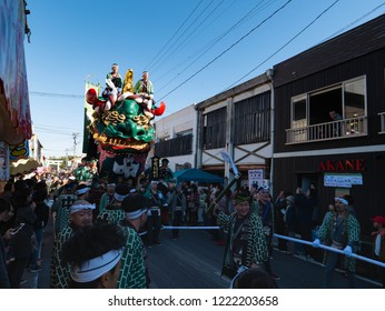 Karatsu city Saga JAPAN - November 3 2018: Autumn festival with people pull floats around through streets in city.  Float shape is green lion head. It is Karatsu Kunchi. From November 2 to 4.
