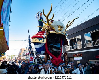 Karatsu city Saga JAPAN - November 3 2018: Autumn festival with people pull floats around through streets in city.  Float shape is samurai helmet. It is Karatsu Kunchi. From November 2 to 4.