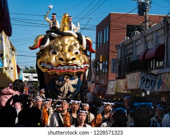 Karatsu city Saga JAPAN - November 3 2018: Autumn festival with people pull floats around through streets in city.  Float shape is golden lion. It is Karatsu Kunchi. From November 2 to 4.