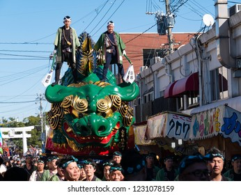 Karatsu city Saga JAPAN - November 3 2018: Autumn festival with people pull floats around through streets in city.  Float shape is green lion on a ball. It is Karatsu Kunchi. From November 2 to 4.