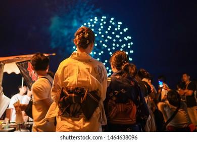 Karatsu, Japan - July 14, 2019: Japanese girls wearing kimono are seen viewing Fireworks in Karatsu, Saga Prefecture.